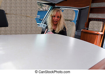 Woman in a luxury mobile home