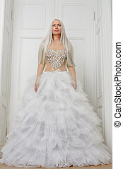 Woman in a luxury white dress