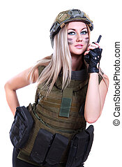 Woman in a military camouflage with a radio