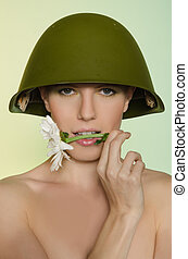 Woman in a military helmet with chamomile mouth