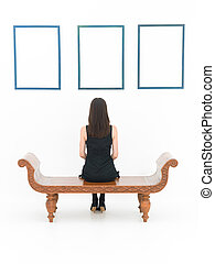 woman in a museum - rear view of woman sitting on a wooden...