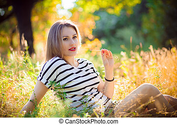 woman in a park at sunset