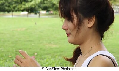 woman in a park drinking water