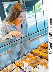 Woman in a pastry shop