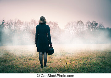 Woman in a pink mist