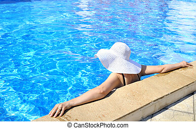 Woman in a pool relaxing