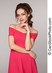woman in a red dress with beautiful hairstyle. Isolated