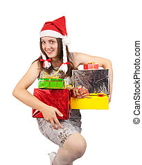 woman in a santa hat with Christmas gifts