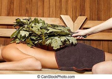 Woman in a sauna.