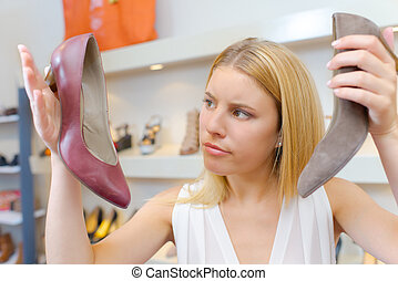 Woman in a shoe shop