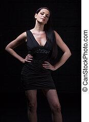 woman in a short black dress