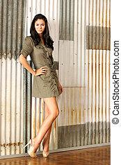 Woman in a Short Dress and High Heels - A pretty brunette...