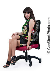 woman in a silk dress sitting on a chair