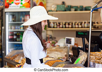 Woman in a store is buying products