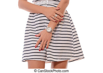 woman in a striped dress standing on white background
