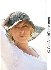 Woman in a summer hat
