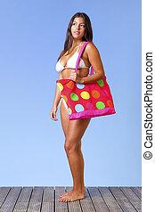 Woman in a white bikini full length