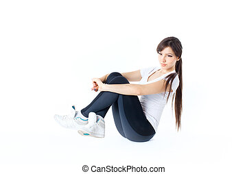 Woman in active wear sitting on floor