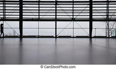 Woman in airport terminal - Woman walking in airport...