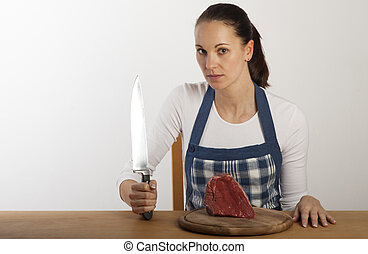 woman in an apron on a table
