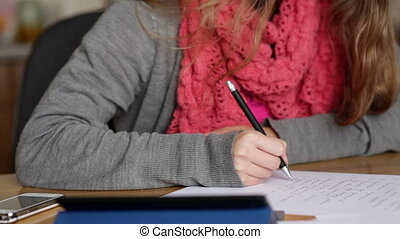 woman in an office with pen writing