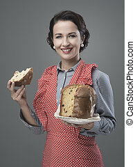 Woman in apron eating panettone - Vintage woman in apron ...