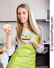 woman in apron with cakes