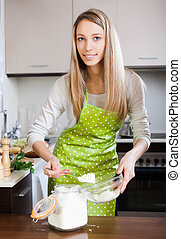 woman  in apron with  flour