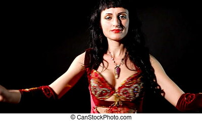 woman in arabic costume shake breas