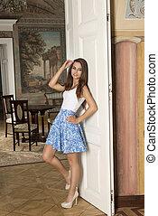 woman in aristocratic room
