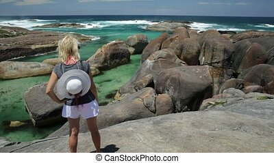 Woman in Australia - Woman with hat on top of Elephant Rocks...