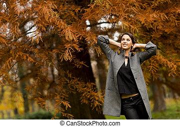 Woman in autumn park