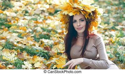 Woman in Autumn Wreath Posing