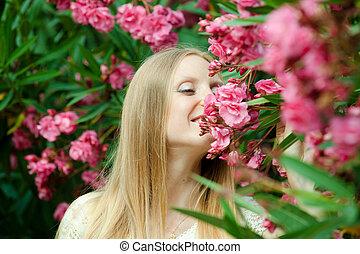 woman in azalea plant