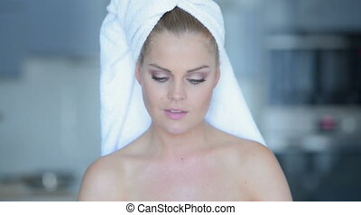 Woman in Bath Towel Talking on Cell Phone