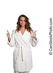 Woman in bathrobe standing on white background