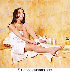 Woman in bathroom. - Woman drying towel in bathroom.
