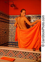 woman in bathroom with towel