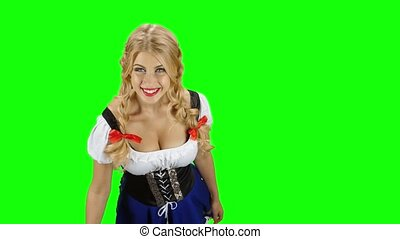 Woman in bavarian costume gives someone a beer on oktoberfest. Green screen