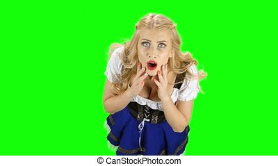 Woman in bavarian national costume laughs. Green screen