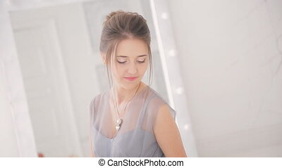 Woman in beautiful dress participate in photo shoot inside apartment
