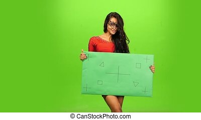 woman in beautiful red dress and ornate carnival mask. blank sign, green screen