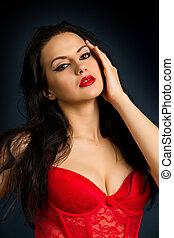 woman in beautiful red lingerie on dark background