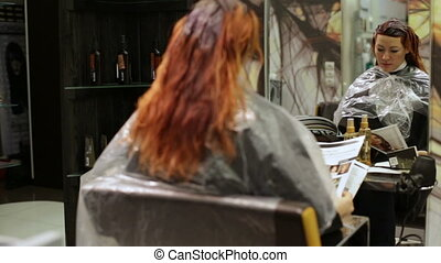 Woman in beauty salon reading a magazine