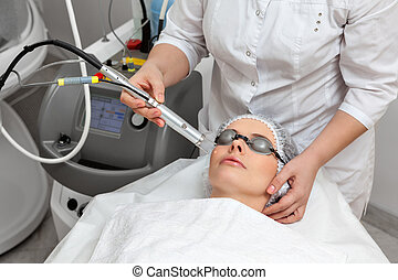 Woman in beauty spa salon - Woman lying on a table with...