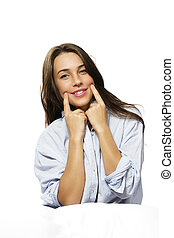woman in bed forcing herself to smile on white background