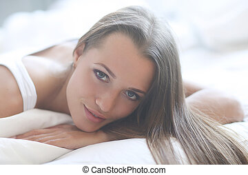 Woman in bed - Lifestyle. Woman lying in bed