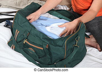 woman in bed packing