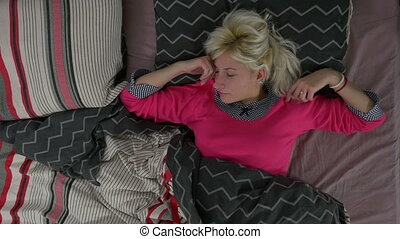 Woman in bed sleeping top view