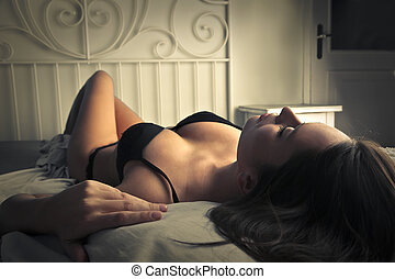 Woman in bed - Woman laying on bed